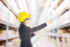 Store manager counting stock in warehouse Stock Image