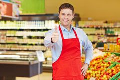 Store manager holding thumbs up. Happy store manager holding his thumbs up in a supermarket Stock Photos