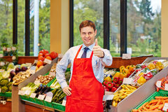 Store manager in supermarket. Smiling store manager in a supermarket holding his thumbs up Stock Images
