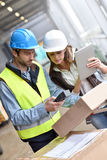 Store manager and warehouseman working. Store manager with warehouseman checking goods reception Royalty Free Stock Photography