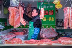 Free Store Owner At Shanghai Wet Markets, China Royalty Free Stock Photo - 175759245