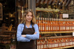 Store owner in front of shop Royalty Free Stock Photos