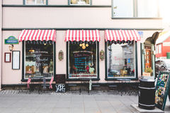 Store With Red and White Stripe Awnings Royalty Free Stock Photos