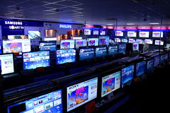 Rows of TVs stand on shelves. Store with rows of TVs stand on shelves with big diagonal and various brands Royalty Free Stock Photography