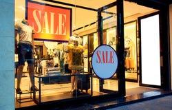 Fashion shop store sale window. Modern clothing store sale window, fashion clothes retail shop display window Stock Images