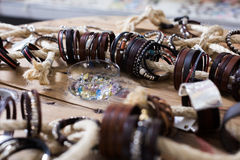 The store selling different leather bracelets. With clasp stock image