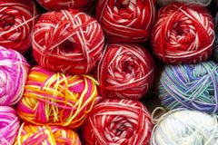 Store shelf with color yarn for knitting with needles, crochet hook. stock photography