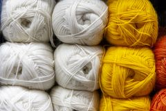 Store shelf with color yarn for knitting with needles, crochet hook. royalty free stock photography