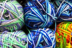 Store shelf with color yarn for knitting with needles, crochet hook. stock photos