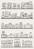 Store shelves with goods. Store shelves with different preserves and canned goods Royalty Free Stock Photography