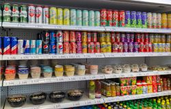 Store Shelves With Soft Drinks And Snacks In Bratislava, Slovakia. Stock Photos