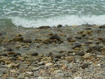 Store shoreline at Mo koh Lanta. Showing waves is coming in Stock Photography
