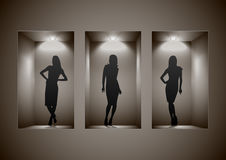 Store showcase with female silhouettes Stock Image