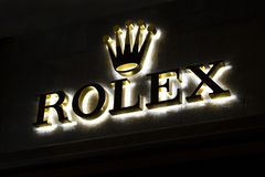Store signboard rolex with brand logo. Shop of premium luxury clock in Barcelona, Catalonia, Spain. 2019-05-01.  stock photos