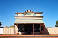 Empty store building in outback town in Western Australia. A store sits empty on the side of a road in an outback ghost town in Western Australia. The building royalty free stock images