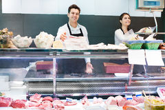 Store staff selling meat and salo Stock Photo