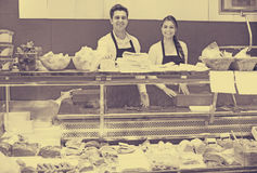 Store staff selling meat and salo Royalty Free Stock Images