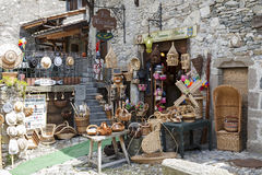 The store by the street in Yvoire. Yvoire, France - May 24, 2013: The store outside a historical house that was built of stone can be seen along the street in Royalty Free Stock Images