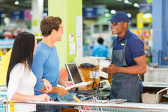 Store till point. Couple paying at hardware store till point Royalty Free Stock Photo