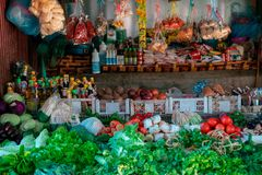 Store of a vendor in the luang prabang food markten in laos. Fresh vegetables and fruits to choice and other ingredients . royalty free stock photo