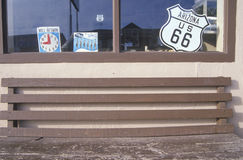 A store window with a Route 66 sign Stock Photo