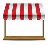 Store  window  with striped awning Royalty Free Stock Photos