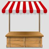 Store window  with striped awning Stock Photography