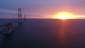 Storebaelt bridge over sea at sunset stock footage