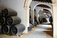 Sherry barrel store in Jerez de la Frontera in Andalusia, Spain. Stored barrels in warehouse at Sherry bodega in Jerez de la Frontera, Andalusia Spain royalty free stock image