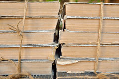 Stored books. Pile of books bound with rope in library depot store on the table Royalty Free Stock Image