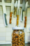 Stored fusilli pasta. Dry fusilli pasta in a covered glass jar Royalty Free Stock Photography