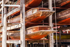Stored hulls. Many thai wooden hulls stored on a wooden scaffolding Royalty Free Stock Images