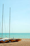 Stored sailboats on the beach. With clear blue sky Royalty Free Stock Image