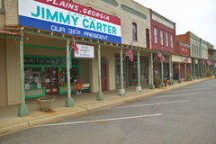 Storefront with banner exclaiming Plains Georgia to be the home of Jimmy Carter, our 39th President in Plains, Georgia Stock Photos