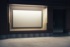Storefront with billboard at night Royalty Free Stock Images