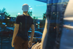 Storefront boutique mannequin, male figure portrait. Storefront boutique mannequin with clothes on sale, male figure portrait, selective focus Stock Photo