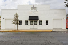 Storefront building with two garages Royalty Free Stock Images