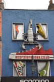 Storefront in Camden town. Colored storefront with shoes and a scorpio in Camden town. London Royalty Free Stock Photos