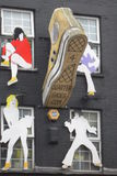 Storefront in Camden town. London. Shoe and persons Royalty Free Stock Photos