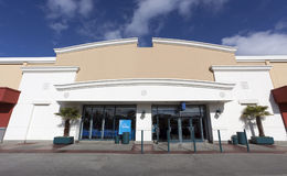 Storefront mall entrance. Horizontal. Symmetrically designed mall entrance under blue sky Royalty Free Stock Photo