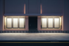 Storefront with many posters. Front view of storefront with numerous empty posters at night. Mock up, 3D Rendering stock illustration