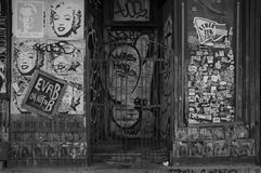 Storefront plastered with graffiti and posters Stock Photo