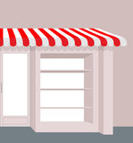 Storefront with striped roof. Red and white stripes of canopy ov Royalty Free Stock Image
