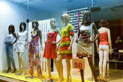 Storefront with women-mannequins Royalty Free Stock Images