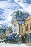 Storefronts and ski slope in the town of Aspen, Colorado Stock Images