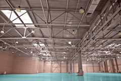 Storehouse. Modern empty storehouse with windows in the roof Royalty Free Stock Photo