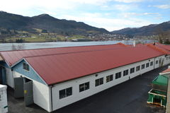 Storehouse. With red roof in production area Royalty Free Stock Photo