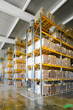 Storehouse shelf. Tall shelves and racks in distribution storehouse royalty free stock images