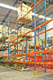 Storehouse shelves. Big warehouse storage room with boxes and shelves Royalty Free Stock Photography