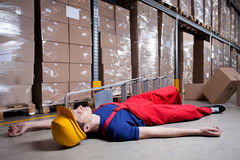 Storekeeper after accident on a ladder. Horizontal stock photography